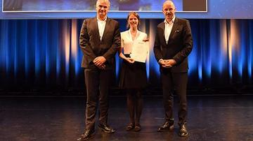 Prof Marcus Altfeld (left), Dr Angelique Hölzemer (centre) with Prof Georg M. N. Behrens at the award ceremony in Salzburg